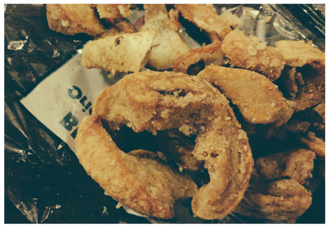 Pork scratchings on a pub table.