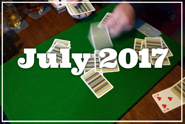 A game of cards in a pub: 'July 2017'.