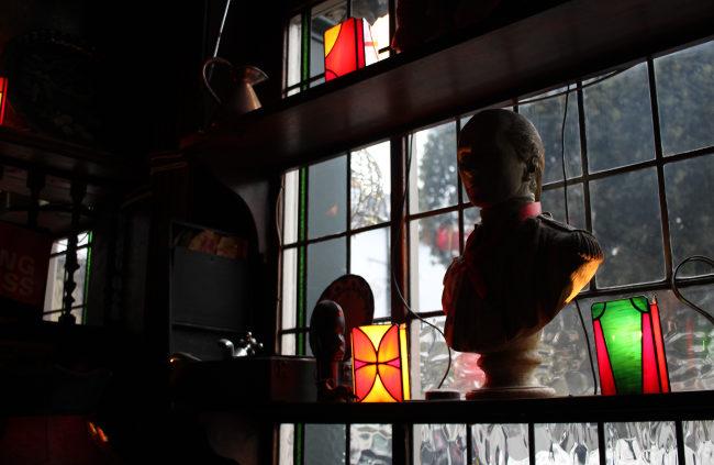 The dark windows of a pub.
