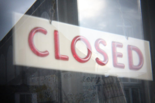 Closed sign on shop.