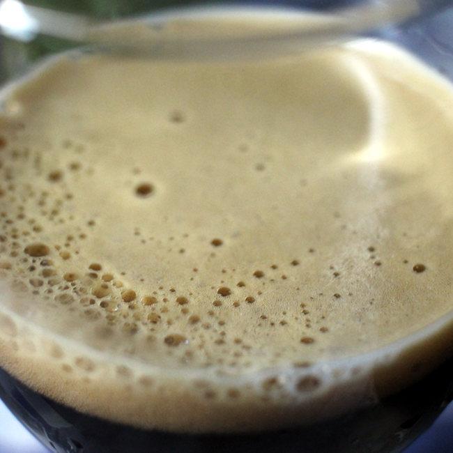 The foam in the glass.