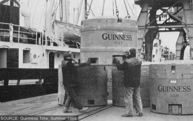 Dockside scene with huge Guinness tanks.
