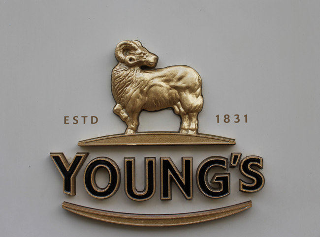 Young's brewery logo on the outside of a pub.