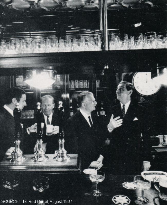Several posh men in a pub.