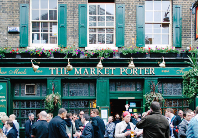 A crowd outside the Market Porter.