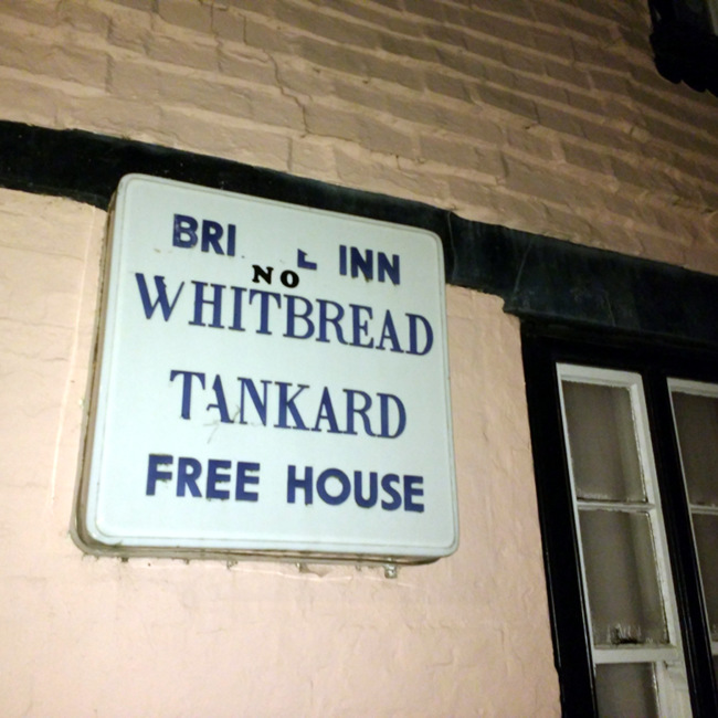 "Sign: ""BRIDGE INN, A WHITBREAD TANKARD FREE HOUSE"""
