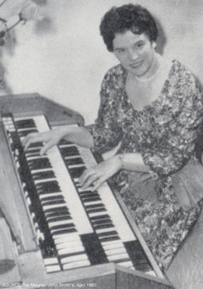 A woman plays the Hammond organ.