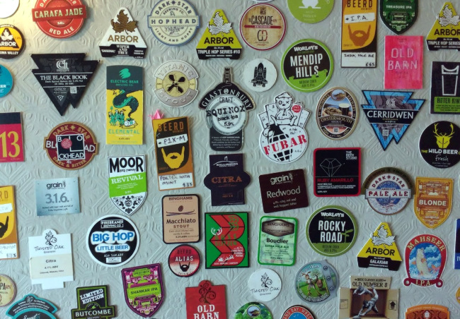 Pump-clips on the wall at The Hare, Bedminster.