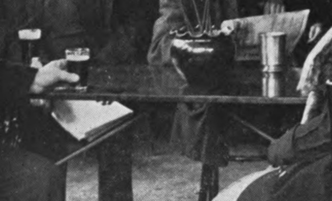 Detail from an Edwardian image of people in a London pub.