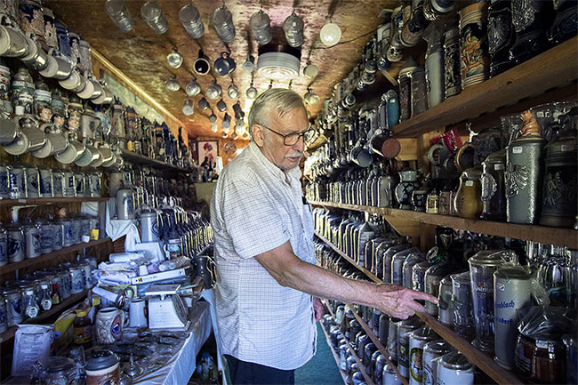 George Adams with his collection of beer steins.
