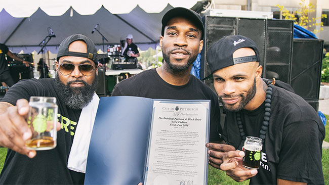 Men at a beer festival.