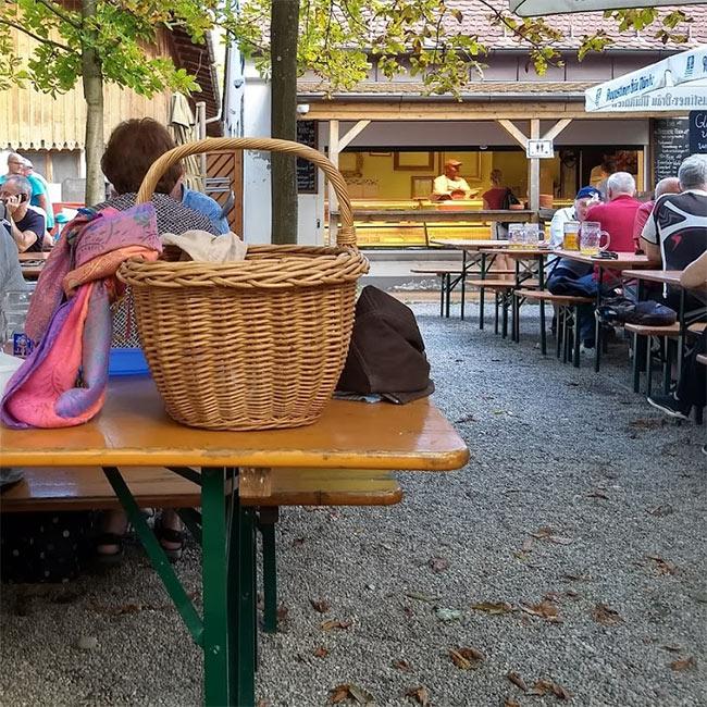 A picnic basket in a beer garden.