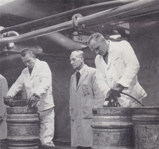 More men working with more metal casks.