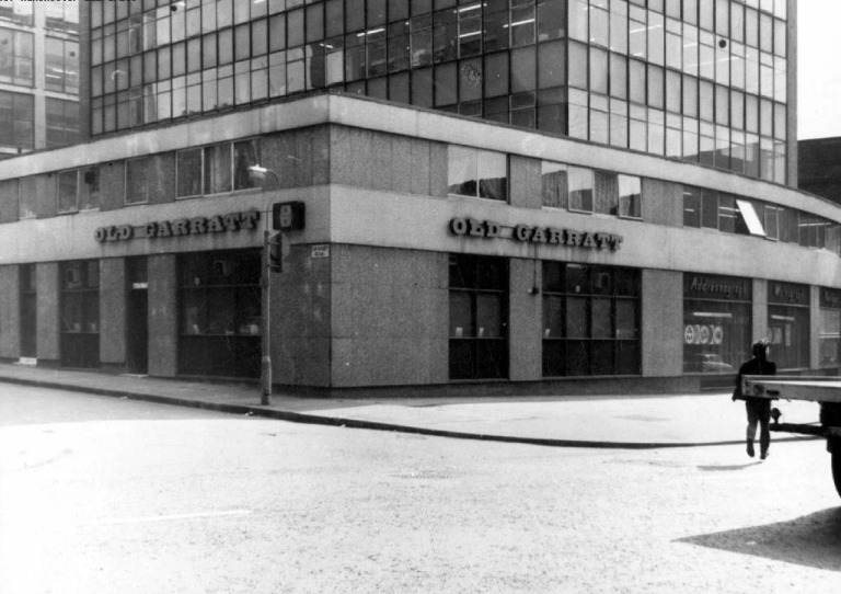 A vintage image a flat-roofed pub.