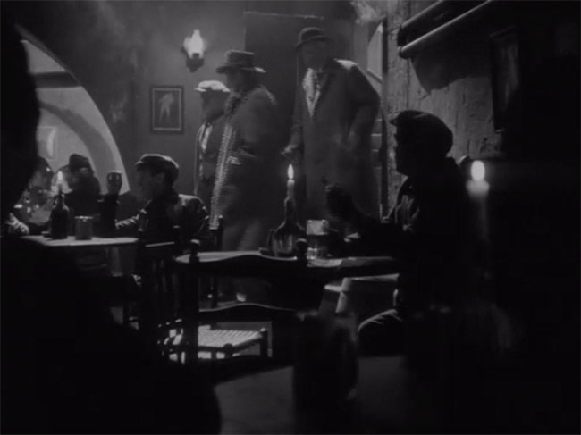 Holmes and Watson enter the pub.